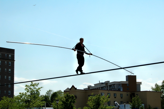 Man Walking Tightrope